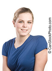 Headshot portrait of teenage girl in blue blouse - Friendly...