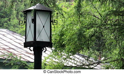 old-fashioned lamp post - close-up old rusty lantern behind...