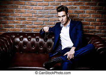 classy style - Imposing well dressed man in a luxurious...