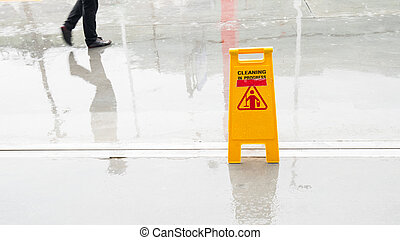 Yellow Wet Floor in rain season. - Yellow Wet Floor in rain...