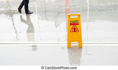 Yellow Wet Floor in rain season. - Yellow Wet Floor in rain...