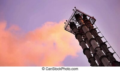 Smoking chimneys of the factory on blue sky background