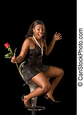 Ecstatic African-American woman with rose flower - Sensual...