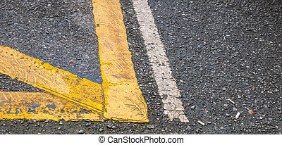 Yellow line on the road.