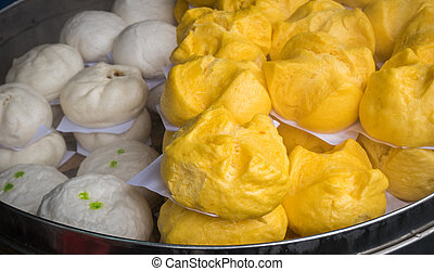 Steamed bun with steaming basket in chinese restaurant