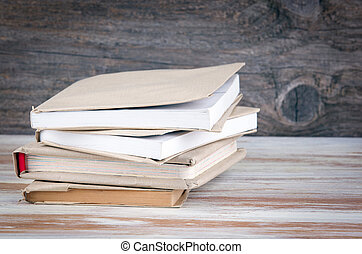 Stack of books on a wooden table