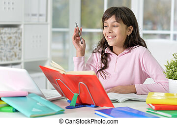 girl doing homework - Portrait of a girl doing homework,...