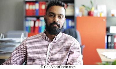 happy smiling man with beard at office - business, emotion,...