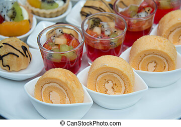 Serving tray of decorative assorted desserts - A Serving...