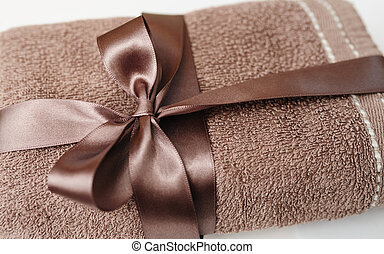 Brown towel tied with a bow - Brown towel tied with a brown...