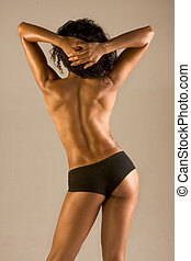 Topless athletic muscular build beautiful woman