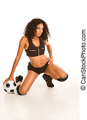 Sexy soccer player sporty ethnic woman with ball