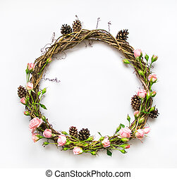 Festive wreath of vines with decorative roses, leaves and...