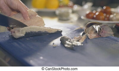 Chef is cutting raw fish, slow motion