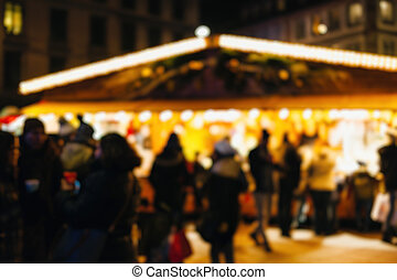 Defocused people eating Christmas Market