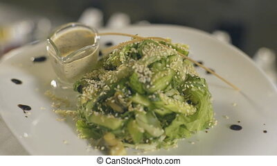 Fresh seaweed salad on white dish, slow motion - Fresh...