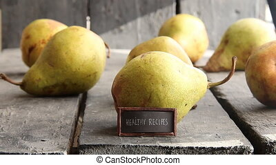 healthy recipes - tag with an inscription and pears on old...