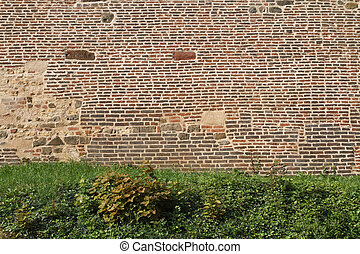 fragment of old brick fortress wall close-up. Prague -...