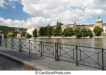 Embankment in Prague. View of the River Vltava and Prague...