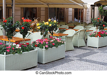 Cafe on the street of the European city. summer. floral...