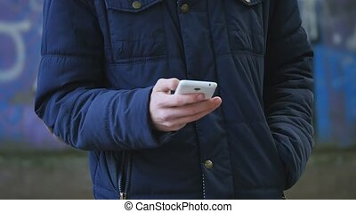 Teenage boy with mobile phone
