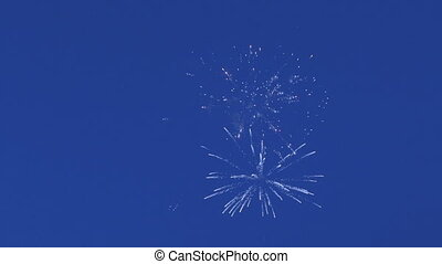 Beautiful fireworks on background of blue sky. - Beautiful...