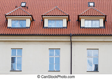 Typical building in Prague with a red roof close up. details