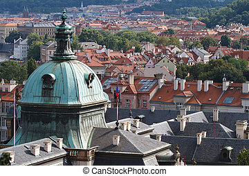 Aerial view of cityscape of Prague. dome of the Straka Academy