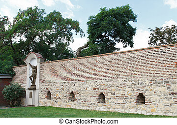 Wall in Visegrad decorated with a statue of St. Sebastian....