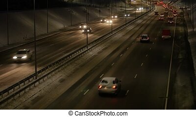 Traffic jam on a highway at night. - Traffic jam on a...