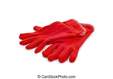 red fleece gloves - a pair of warming red fleece gloves on a...
