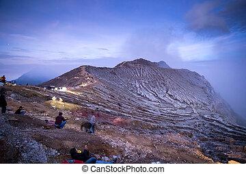 Mount Kawah Ijen volcano during sunrise in East Java,...