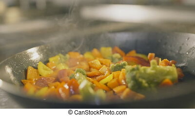 Cooking many different veggies, slow motion - Cooking many...