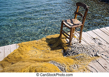 Wooden chair and fishing net - Wooden chair for fisherman...