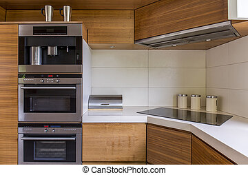 Modern kitchenette with wooden furniture - Close-up of...
