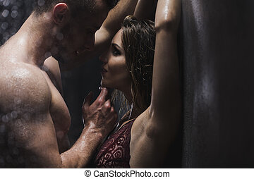 Woman and man in the shower - Woman in a lacy bra and...