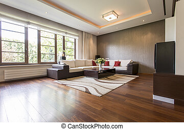 Modern living room design with brown parquet