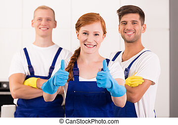 Cleaning lady wearing uniform - Cleaning lady and two men...