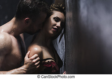Woman in bra with man - Woman in a lace bra is standing back...