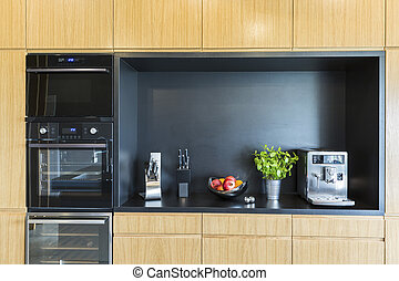 Oven and coffee machine in modern kitchen