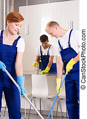 Cleaners mopping flor - Group of professional cleaners...