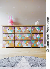 Cozy child's room with color chest of drawers