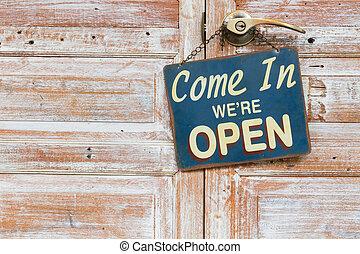 Come In We're Open on the wooden door