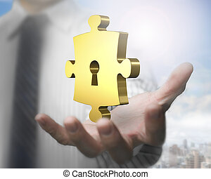 Man hand showing golden puzzle piece with keyhole - Man's...