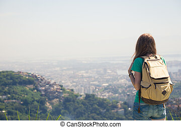 girl looking at the Rio - girl tourist with backpack looking...