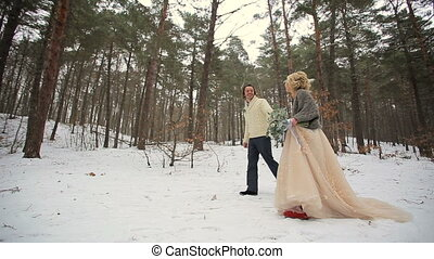 Winter Forest Walking of Wedding Couple