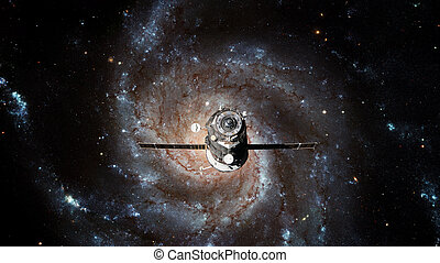 Spacecraft Progress orbiting the galaxy. Elements of this...