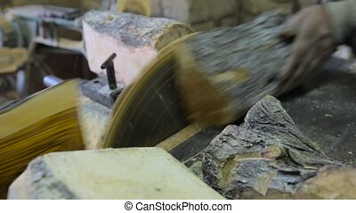 Carpenter Using Circular Saw cutting wood in workshop -...