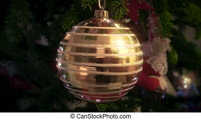 Rotating Christmas ball - Rotating golden Christmas ball on...