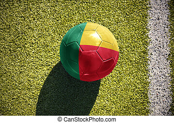 football ball with the national flag of benin lies on the...